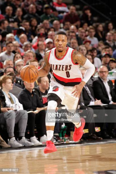 Damian Lillard of the Portland Trail Blazers drives to the basket against the Milwaukee Bucks on March 21 2017 at the Moda Center in Portland Oregon...
