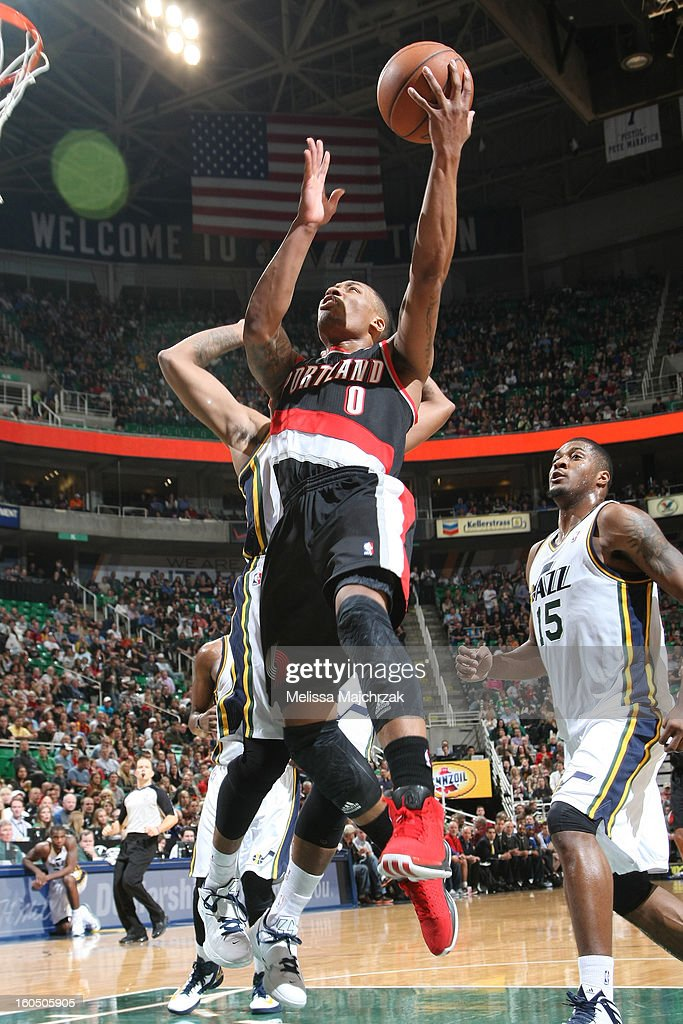 <a gi-track='captionPersonalityLinkClicked' href=/galleries/search?phrase=Damian+Lillard&family=editorial&specificpeople=6598327 ng-click='$event.stopPropagation()'>Damian Lillard</a> #0 of the Portland Trail Blazers drives to the hoop against <a gi-track='captionPersonalityLinkClicked' href=/galleries/search?phrase=Derrick+Favors&family=editorial&specificpeople=5792014 ng-click='$event.stopPropagation()'>Derrick Favors</a> #15 of the Utah Jazz at Energy Solutions Arena on February 01, 2013 in Salt Lake City, Utah.