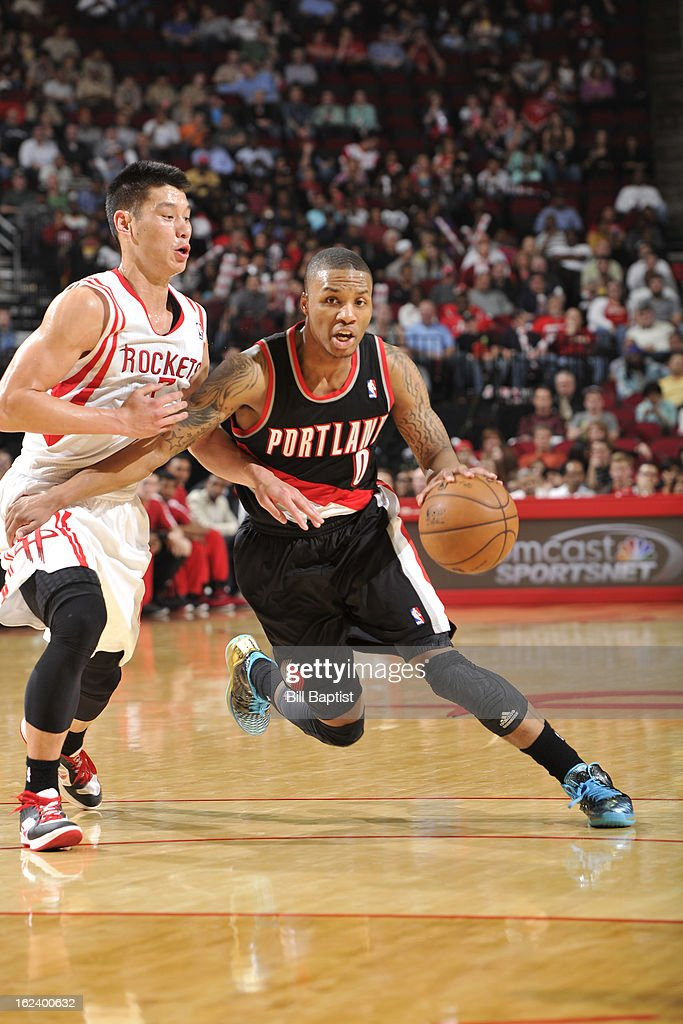 <a gi-track='captionPersonalityLinkClicked' href=/galleries/search?phrase=Damian+Lillard&family=editorial&specificpeople=6598327 ng-click='$event.stopPropagation()'>Damian Lillard</a> #0 of the Portland Trail Blazers drives to the rim against <a gi-track='captionPersonalityLinkClicked' href=/galleries/search?phrase=Jeremy+Lin&family=editorial&specificpeople=6669516 ng-click='$event.stopPropagation()'>Jeremy Lin</a> #7 of the Houston Rockets on February 8, 2013 at the Toyota Center in Houston, Texas.