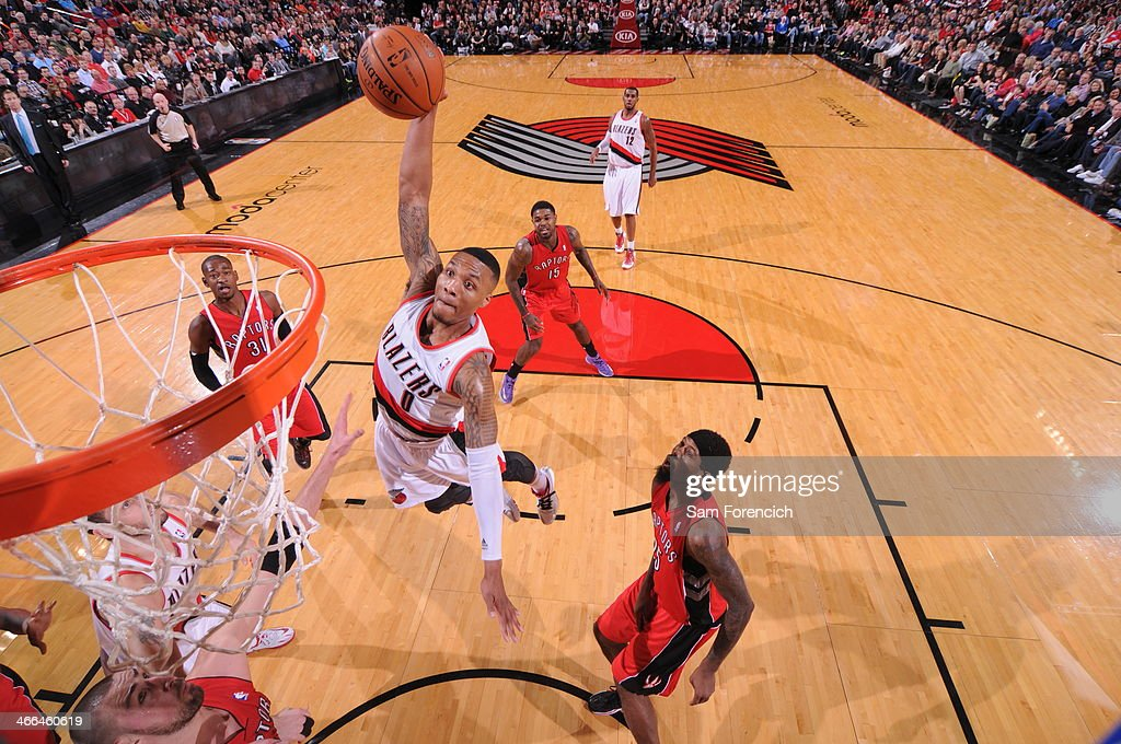 <a gi-track='captionPersonalityLinkClicked' href=/galleries/search?phrase=Damian+Lillard&family=editorial&specificpeople=6598327 ng-click='$event.stopPropagation()'>Damian Lillard</a> #0 of the Portland Trail Blazers dunks against the Toronto Raptors on February 1, 2014 at the Moda Center Arena in Portland, Oregon.