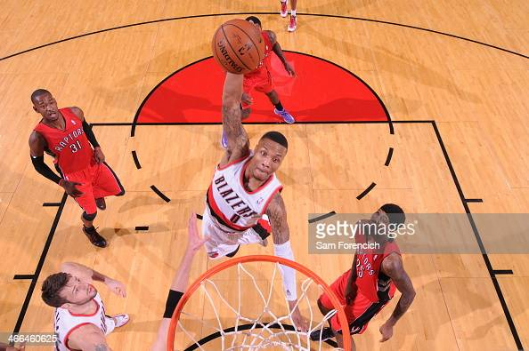 Damian Lillard of the Portland Trail Blazers dunks against the Toronto Raptors on February 1 2014 at the Moda Center Arena in Portland Oregon NOTE TO...