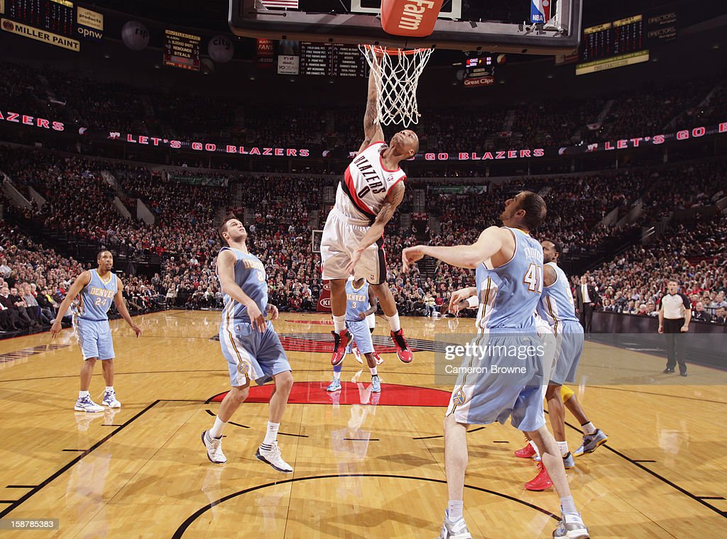 <a gi-track='captionPersonalityLinkClicked' href=/galleries/search?phrase=Damian+Lillard&family=editorial&specificpeople=6598327 ng-click='$event.stopPropagation()'>Damian Lillard</a> #0 of the Portland Trail Blazers dunks the ball against the Denver Nuggets on December 20, 2012 at the Rose Garden Arena in Portland, Oregon.