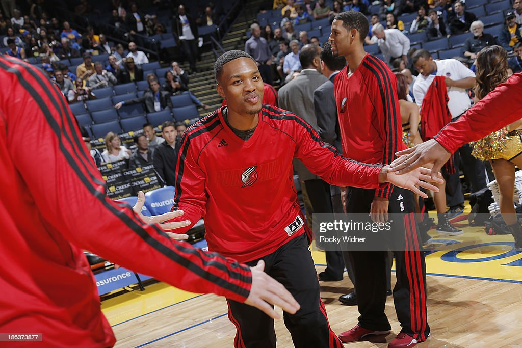 <a gi-track='captionPersonalityLinkClicked' href=/galleries/search?phrase=Damian+Lillard&family=editorial&specificpeople=6598327 ng-click='$event.stopPropagation()'>Damian Lillard</a> #0 of the Portland Trail Blazers gets introduced into the starting lineup against the Golden State Warriors on October 24, 2013 at Oracle Arena in Oakland, California.