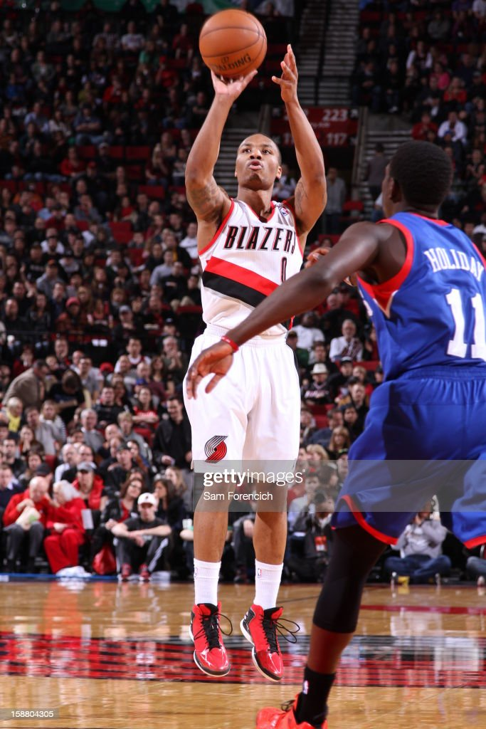 Damian Lillard #0 of the Portland Trail Blazers goes for a jump shot against Jrue Holiday #11 of the Philadelphia 76ers during the game between the Philadelphia 76ers and the Portland Trail Blazers on December 29, 2012 at the Rose Garden Arena in Portland, Oregon.