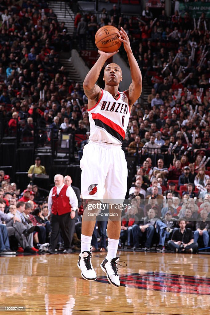 Damian Lillard #0 of the Portland Trail Blazers goes for a jump shot during the game between the Dallas Mavericks and the Portland Trail Blazers on January 29, 2013 at the Rose Garden Arena in Portland, Oregon.