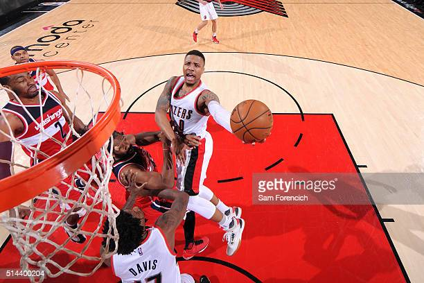 Damian Lillard of the Portland Trail Blazers goes for the layup during the game against the Washington Wizards on March 8 2016 at the Moda Center...