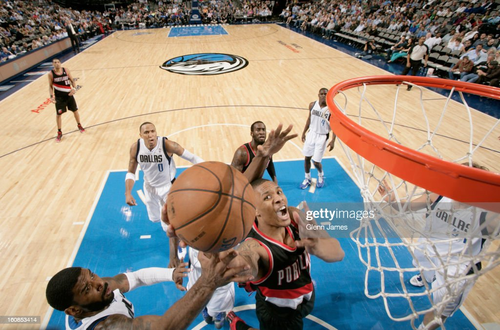 <a gi-track='captionPersonalityLinkClicked' href=/galleries/search?phrase=Damian+Lillard&family=editorial&specificpeople=6598327 ng-click='$event.stopPropagation()'>Damian Lillard</a> #0 of the Portland Trail Blazers goes in for the layup against <a gi-track='captionPersonalityLinkClicked' href=/galleries/search?phrase=O.J.+Mayo&family=editorial&specificpeople=2351505 ng-click='$event.stopPropagation()'>O.J. Mayo</a> #32 of the Dallas Mavericks on February 6, 2013 at the American Airlines Center in Dallas, Texas.