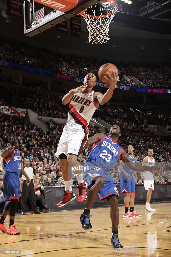 Damian Lillard #0 of the Portland Trail Blazers goes to the basket during the game between the Philadelphia 76ers and the Portland Trail Blazers on December 29, 2012 at the Rose Garden Arena in Portland, Oregon.
