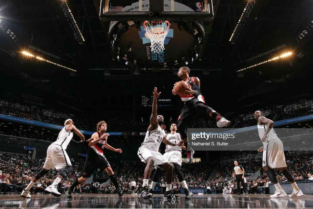 <a gi-track='captionPersonalityLinkClicked' href=/galleries/search?phrase=Damian+Lillard&family=editorial&specificpeople=6598327 ng-click='$event.stopPropagation()'>Damian Lillard</a> #0 of the Portland Trail Blazers goes to the basket against the Brooklyn Nets at Barclays Center on November 18, 2013 in the Brooklyn borough of New York City.
