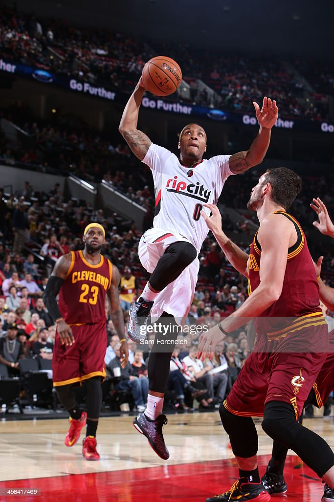 Damian Lillard of the Portland Trail Blazers goes to the basket against the Cleveland Cavaliers on November 4 2014 at the Moda Center in Portland...