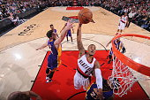 Damian Lillard of the Portland Trail Blazers goes to the basket against the Los Angeles Lakers on January 5 2015 at the Moda Center in Portland...