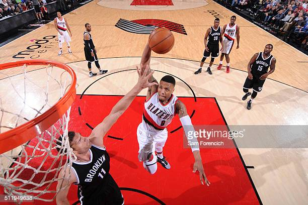 Damian Lillard of the Portland Trail Blazers goes to the basket during the game against the Brooklyn Nets on February 23 2016 at the Moda Center...
