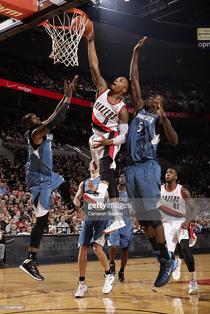 Damian Lillard #0 of the Portland Trail Blazers goes up for a dunk during a game against the Minnesota Timberwolves on February 23, 2014 at the Moda Center Arena in Portland, Oregon.