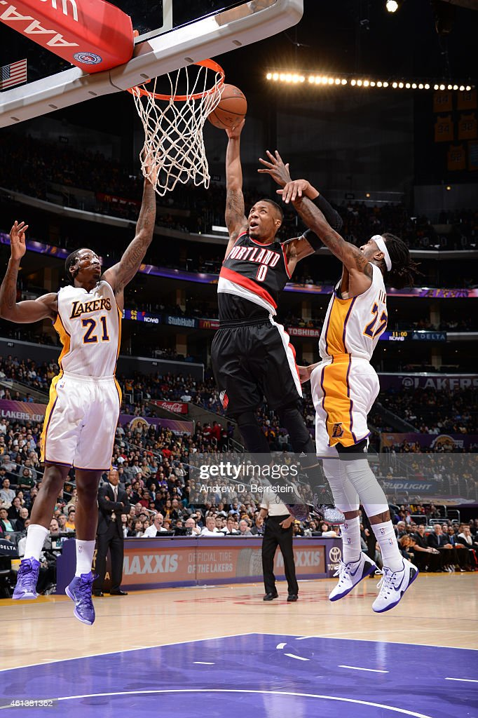 Damian Lillard of the Portland Trail Blazers goes up for a dunk against the Los Angeles Lakers during the game on January 11 2015 at STAPLES Center...