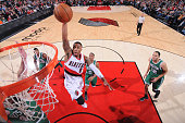 Damian Lillard of the Portland Trail Blazers goes up for a dunk against the Boston Celtics during the game on January 22 2015 at the Moda Center in...