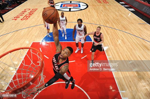 Damian Lillard of the Portland Trail Blazers goes up for a dunk against the Los Angeles Clippers during a preseason game on October 22 2015 at...