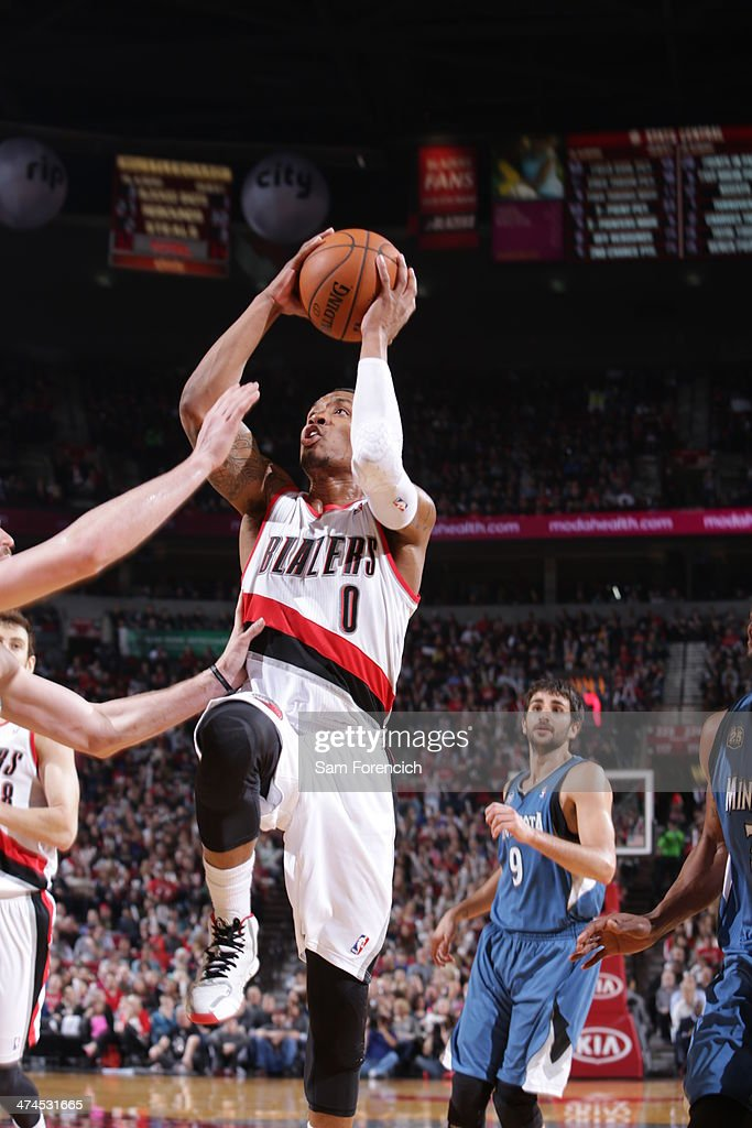 Damian Lillard #0 of the Portland Trail Blazers goes up for a shot during a game against the Minnesota Timberwolves on February 23, 2014 at the Moda Center Arena in Portland, Oregon.