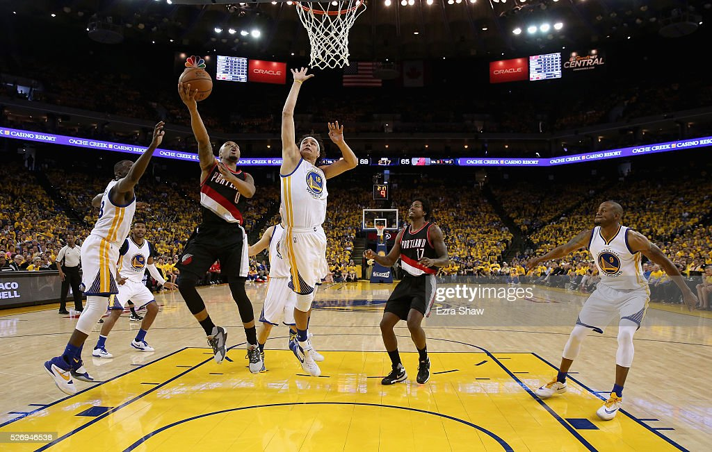 Damian Lillard #0 of the Portland Trail Blazers goes up for a shot against Anderson Varejao #18 of the Golden State Warriors during Game One of the Western Conference Semifinals for the 2016 NBA Playoffs at ORACLE Arena on May 01, 2016 in Oakland, California.