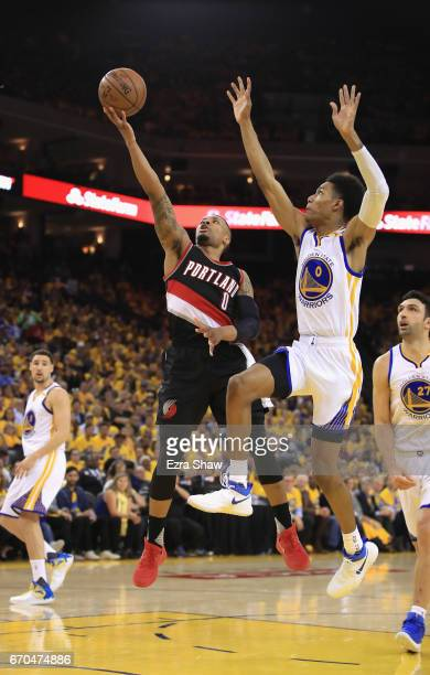 Damian Lillard of the Portland Trail Blazers goes up for a shot against Patrick McCaw of the Golden State Warriors Game Two of the Western Conference...