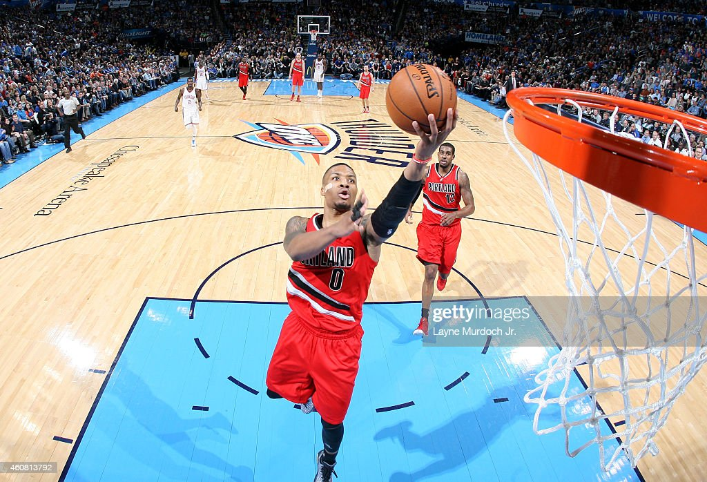 Damian Lillard of the Portland Trail Blazers goes up for a shot against the Oklahoma City Thunder on December 23 2014 at Chesapeake Energy Arena in...
