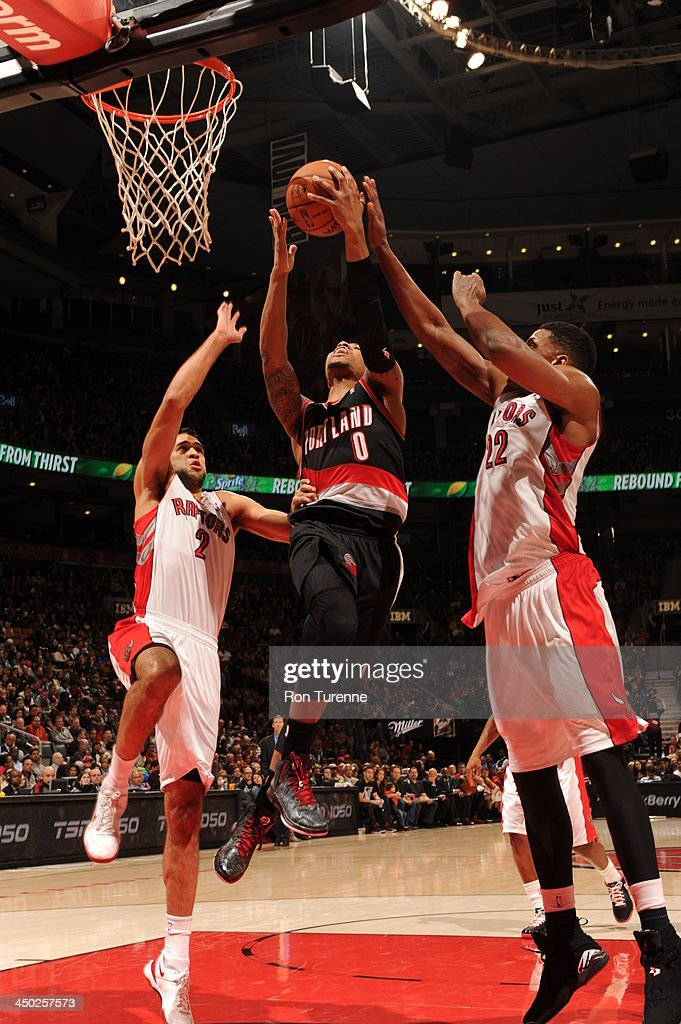 <a gi-track='captionPersonalityLinkClicked' href=/galleries/search?phrase=Damian+Lillard&family=editorial&specificpeople=6598327 ng-click='$event.stopPropagation()'>Damian Lillard</a> #0 of the Portland Trail Blazers goes up for the shot against the Toronto Raptors during the game on November 17, 2013 at the Air Canada Centre in Toronto, Ontario, Canada.