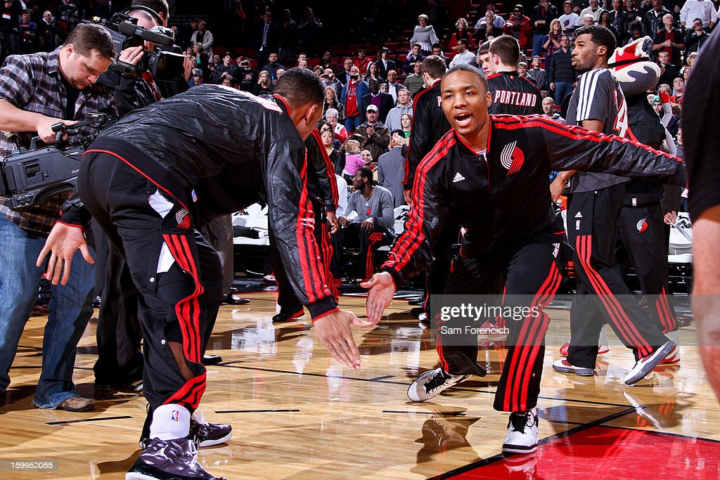 Damian Lillard #0 of the Portland Trail Blazers greets teammates before playing against the Indiana Pacers on January 23, 2013 at the Rose Garden Arena in Portland, Oregon.