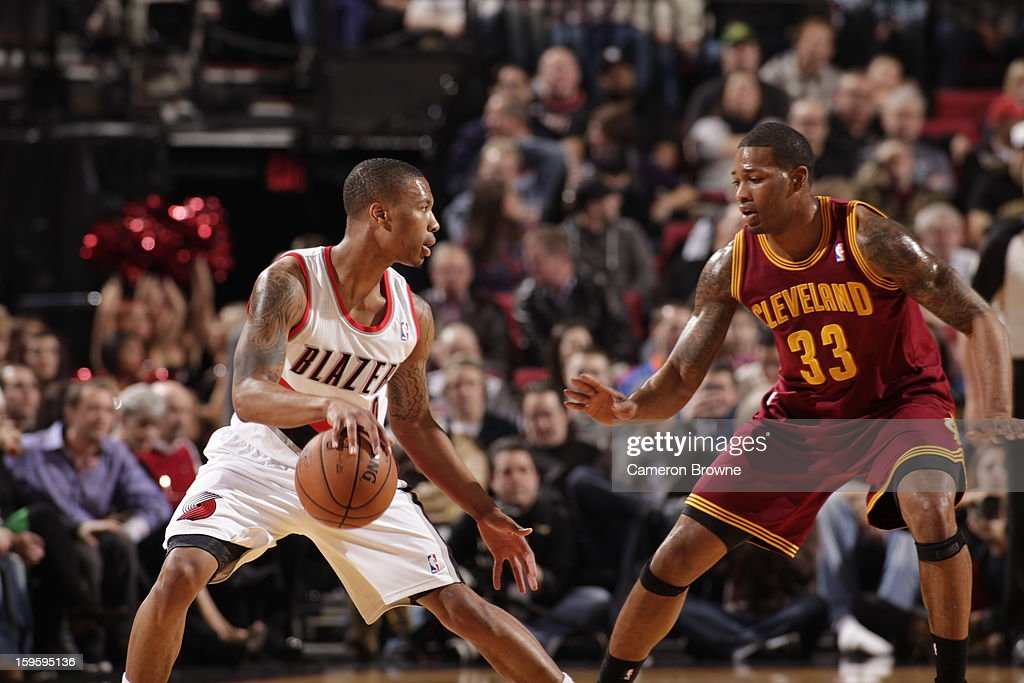 Damian Lillard #0 of the Portland Trail Blazers handles the ball against Alonzo Gee #33 of the Cleveland Cavaliers on January 16, 2013 at the Rose Garden Arena in Portland, Oregon.