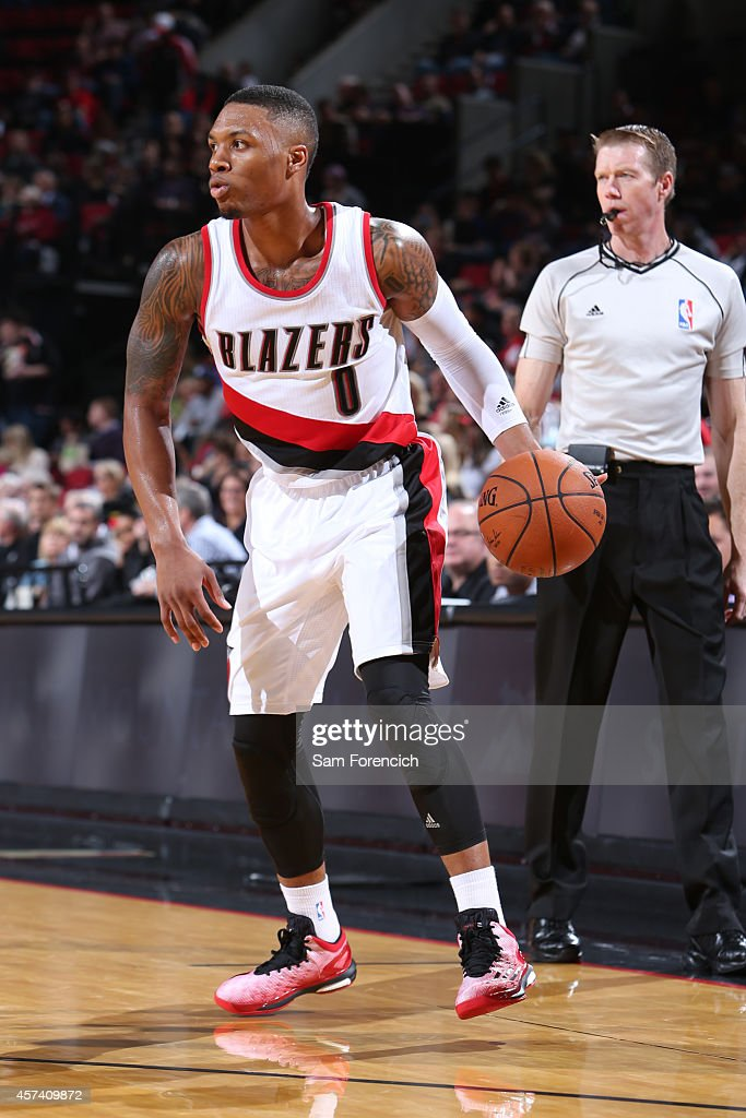 Damian Lillard of the Portland Trail Blazers handles the ball against Maccabi Haifa on October 17 2014 at the Moda Center Arena in Portland Oregon...