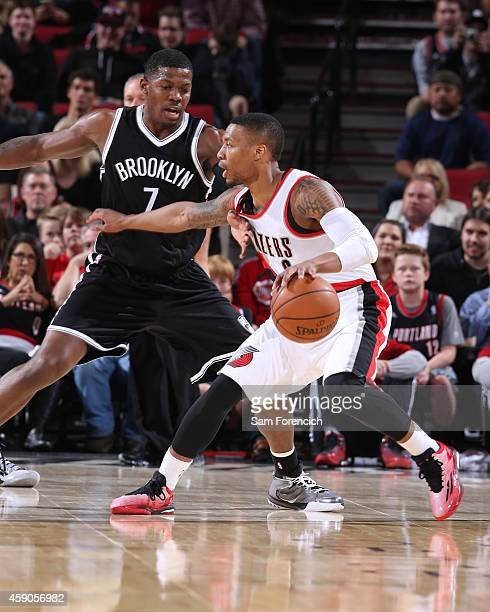Damian Lillard of the Portland Trail Blazers handles the ball against the Brooklyn Nets on November 15 2014 at the Moda Center Arena in Portland...