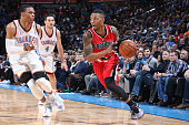 Damian Lillard of the Portland Trail Blazers handles the ball against the Oklahoma City Thunder on December 23 2014 at Chesapeake Energy Arena in...