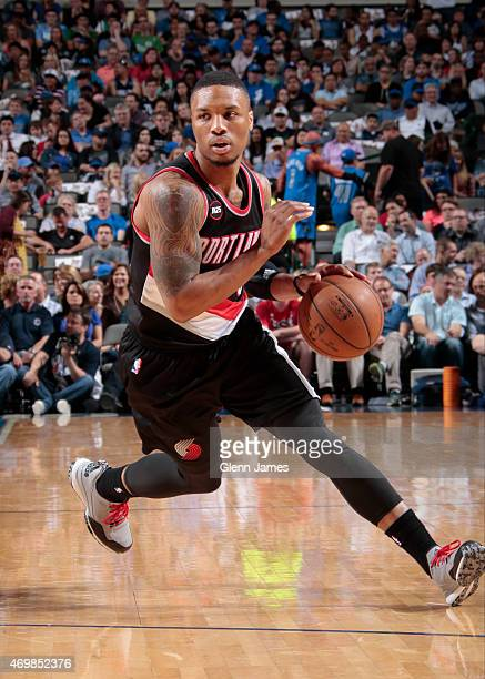 Damian Lillard of the Portland Trail Blazers handles the ball against the Dallas Mavericks on April 15 2015 at the American Airlines Center in Dallas...