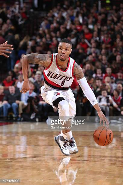 Damian Lillard of the Portland Trail Blazers handles the ball against the San Antonio Spurs on November 11 2015 at the Moda Center Arena in Portland...