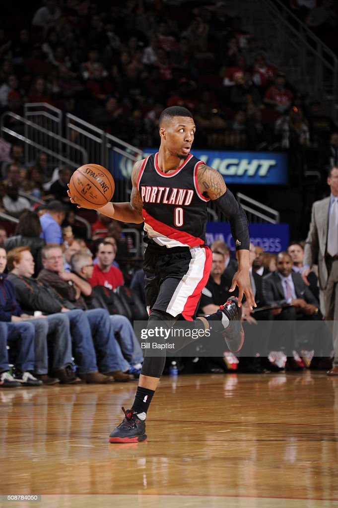 Damian Lillard #0 of the Portland Trail Blazers handles the ball against the Houston Rockets on February 6, 2016 at the Toyota Center in Houston, Texas.