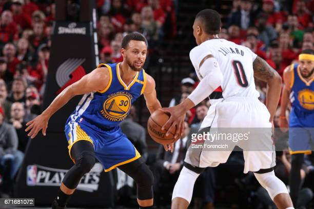 Damian Lillard of the Portland Trail Blazers handles the ball against Stephen Curry of the Golden State Warriors in Game Three of the Western...