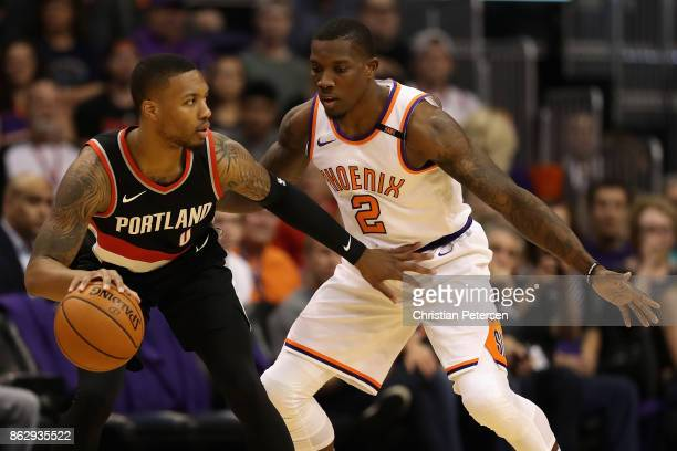 Damian Lillard of the Portland Trail Blazers handles the ball against Eric Bledsoe of the Phoenix Suns during the first half of the NBA game at...