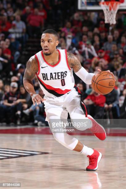 Damian Lillard of the Portland Trail Blazers handles the ball against the Denver Nuggets on November 13 2017 at the Moda Center in Portland Oregon...