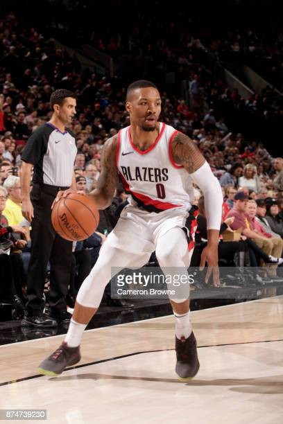 Damian Lillard of the Portland Trail Blazers handles the ball against the Orlando Magic on November 15 2017 at the Moda Center in Portland Oregon...