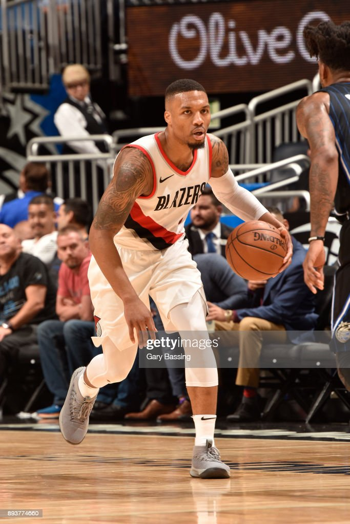 Damian Lillard #0 of the Portland Trail Blazers handles the ball against the Orlando Magic on December 15, 2017 at Amway Center in Orlando, Florida.