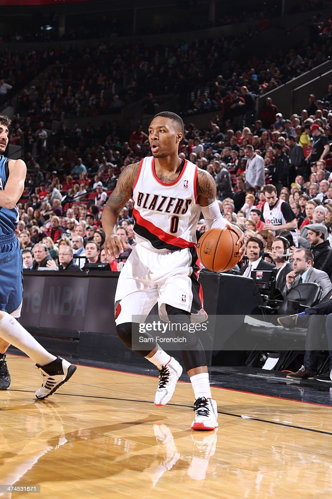 Damian Lillard #0 of the Portland Trail Blazers handles the ball during a game against the Minnesota Timberwolves on February 23, 2014 at the Moda Center Arena in Portland, Oregon.