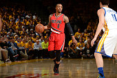 Damian Lillard of the Portland Trail Blazers handles the ball during the game against the Golden State Warriors in Game Five of the Western...
