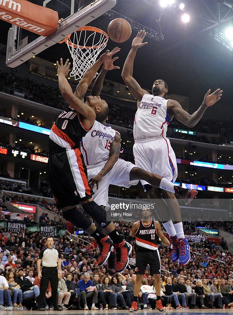 Damian Lillard #0 of the Portland Trail Blazers has his shot blocked by DeAndre Jordan #6 and Eric Bledsoe #12 of the Los Angeles Clippers at Staples Center on January 27, 2013 in Los Angeles, California.