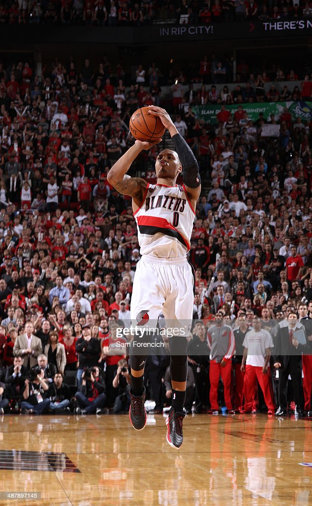<a gi-track='captionPersonalityLinkClicked' href=/galleries/search?phrase=Damian+Lillard&family=editorial&specificpeople=6598327 ng-click='$event.stopPropagation()'>Damian Lillard</a> #0 of the Portland Trail Blazers hits the game winning shot against the Houston Rockets in Game Six of the Western Conference Quarterfinals during the 2014 NBA Playoffs on May 2, 2014 at the Moda Center in Portland, Oregon.