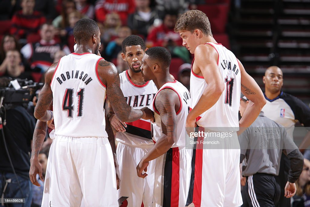 Damian Lillard #0 of the Portland Trail Blazers huddles the team up during the game against the Phoenix Suns on October 9, 2013 at the Moda Center Arena in Portland, Oregon.