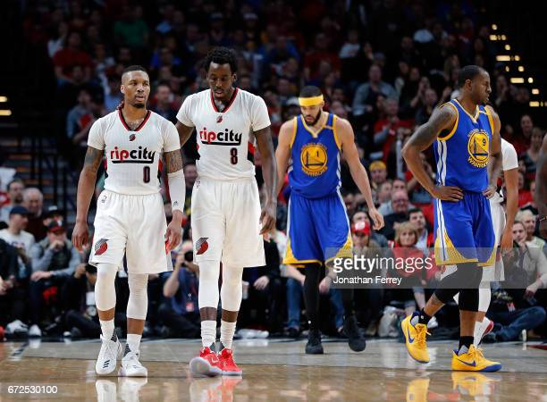 Damian Lillard of the Portland Trail Blazers is calmed down by Al Farouq Aminu after getting called for a technical foul against the Golden State...