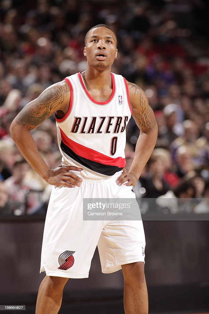 <a gi-track='captionPersonalityLinkClicked' href=/galleries/search?phrase=Damian+Lillard&family=editorial&specificpeople=6598327 ng-click='$event.stopPropagation()'>Damian Lillard</a> #0 of the Portland Trail Blazers looks at the scoreboard during the game against the Sacramento Kings on December 26, 2012 at the Rose Garden Arena in Portland, Oregon.