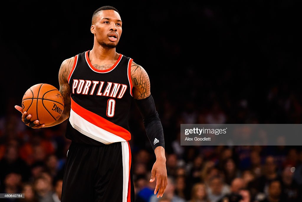 Damian Lillard of the Portland Trail Blazers looks on during a game against the New York Knicks at Madison Square Garden on December 7 2014 in New...