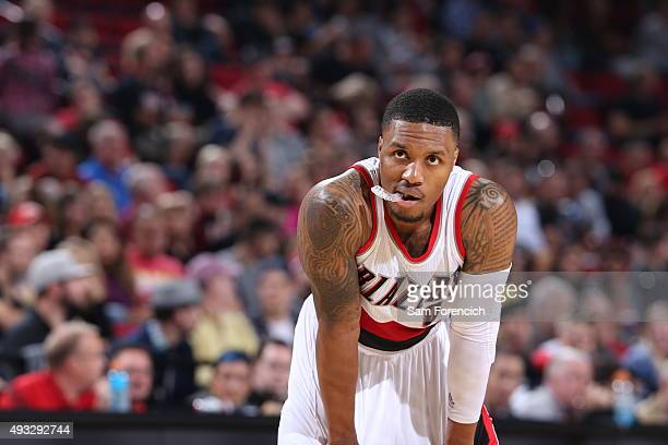Damian Lillard of the Portland Trail Blazers looks on during the game against the Utah Jazz on October 18 2015 at the Moda Center in Portland Oregon...