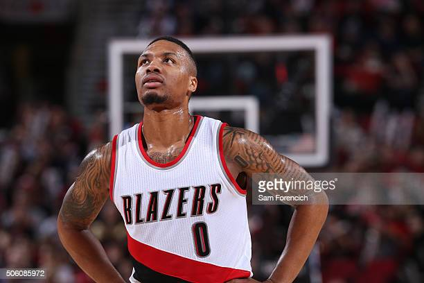 Damian Lillard of the Portland Trail Blazers looks on during the game against the Atlanta Hawks on January 20 2016 at the Moda Center Arena in...