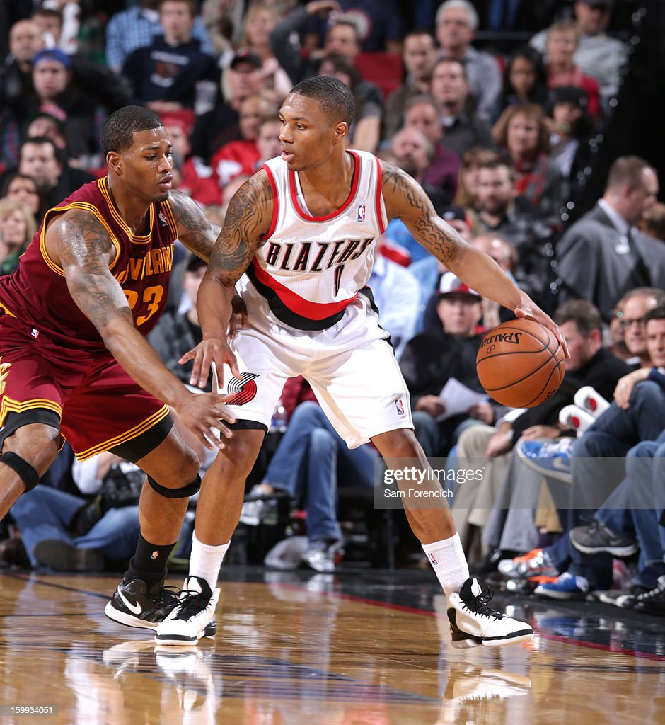 <a gi-track='captionPersonalityLinkClicked' href=/galleries/search?phrase=Damian+Lillard&family=editorial&specificpeople=6598327 ng-click='$event.stopPropagation()'>Damian Lillard</a> #0 of the Portland Trail Blazers looks to drive to the basket against the Cleveland Cavaliers on January 16, 2013 at the Rose Garden Arena in Portland, Oregon.