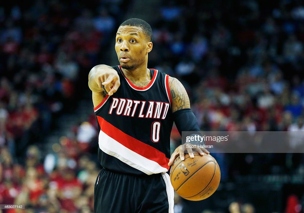 Damian Lillard of the Portland Trail Blazers looks to pass on the court during their game against the Houston Rockets at the Toyota Center on...
